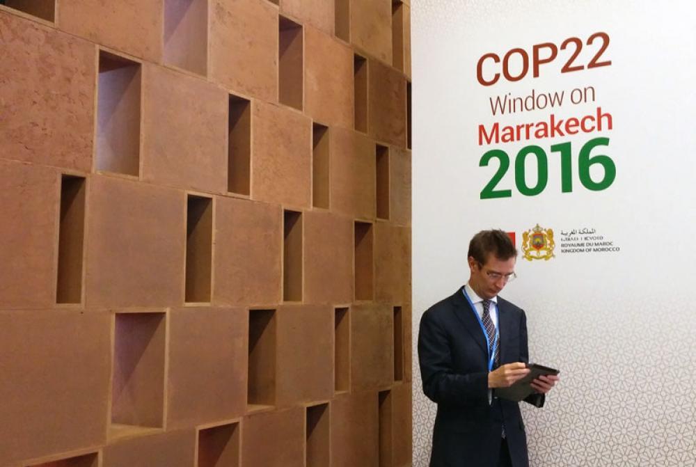 Oras Tynkkynen Pariisin ilmastokokouksessa